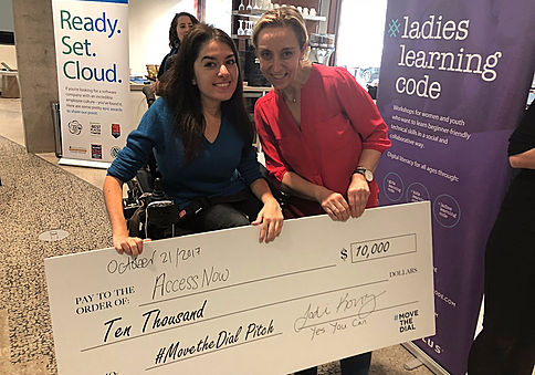 Maayan ziv, left, Jodi Kovitz, right, pose with a cheque for AccessNow.
