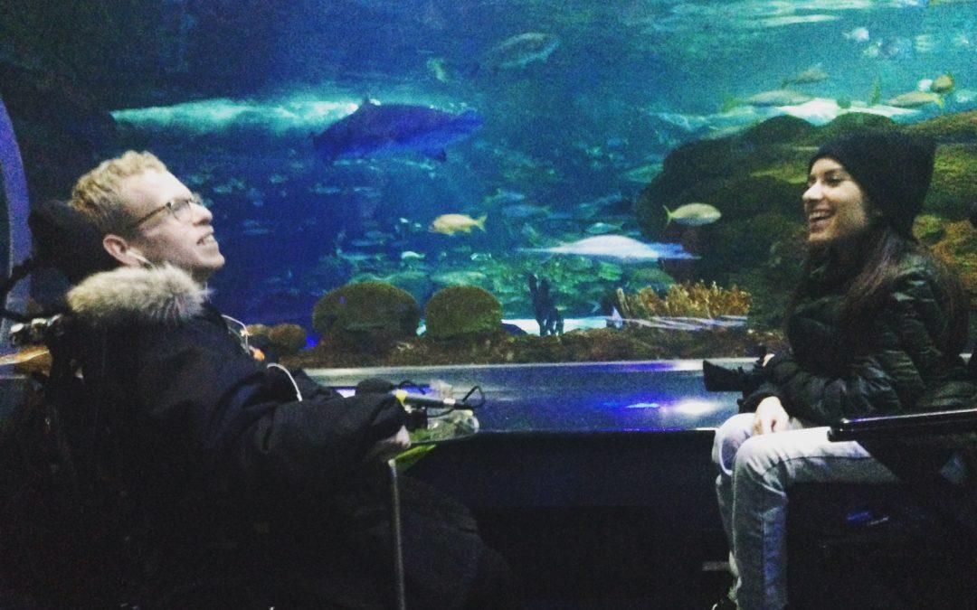 Maayan Ziv and Tim Rose smiling at Ripleys Aquarium