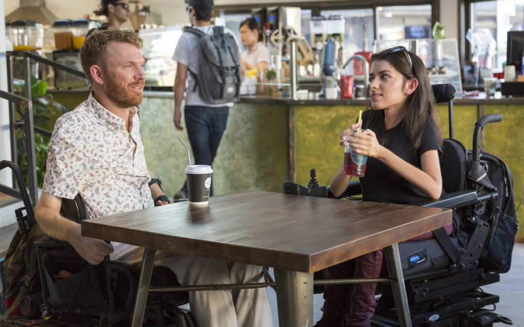 Luke Anderson, left, Maayan Ziv, right, talking at a coffee shop