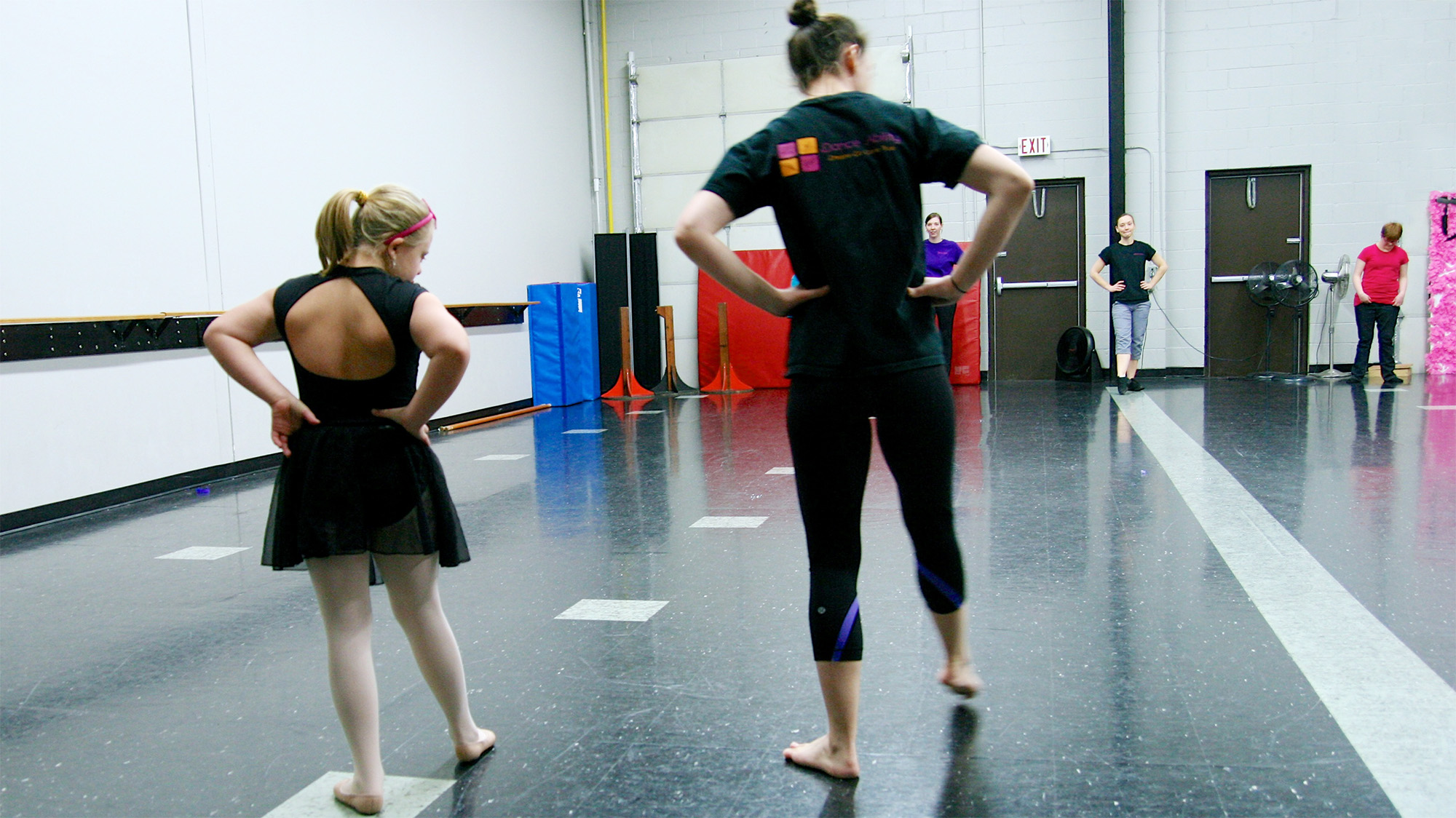 rear shot of two dancers practicing