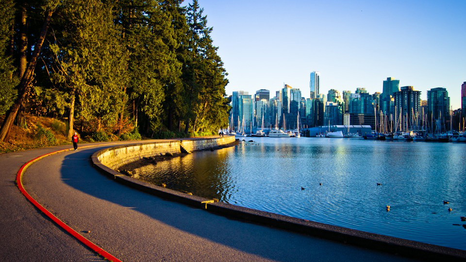 the seawall trail along the pacific ocean with view of vancouver skyline
