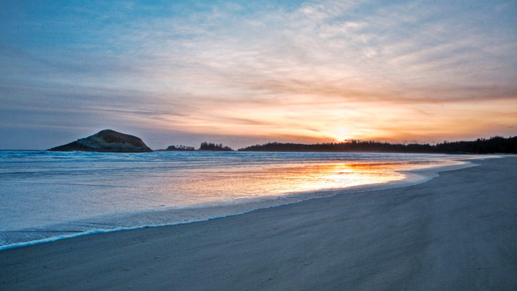 empty white sand beach at sunrise