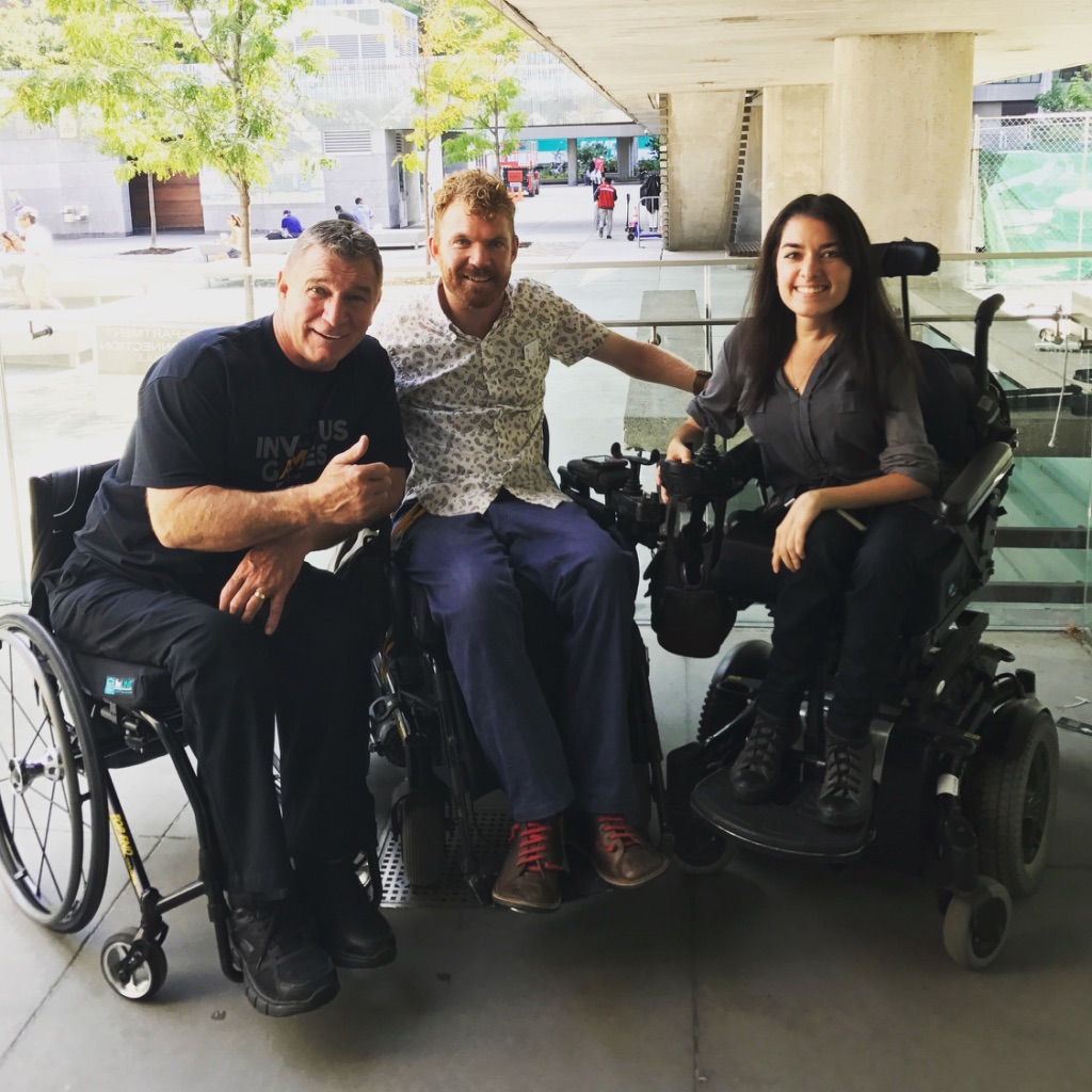 rick hansen, left, luke anderson middle, and maayan ziv, right, pose for photo together