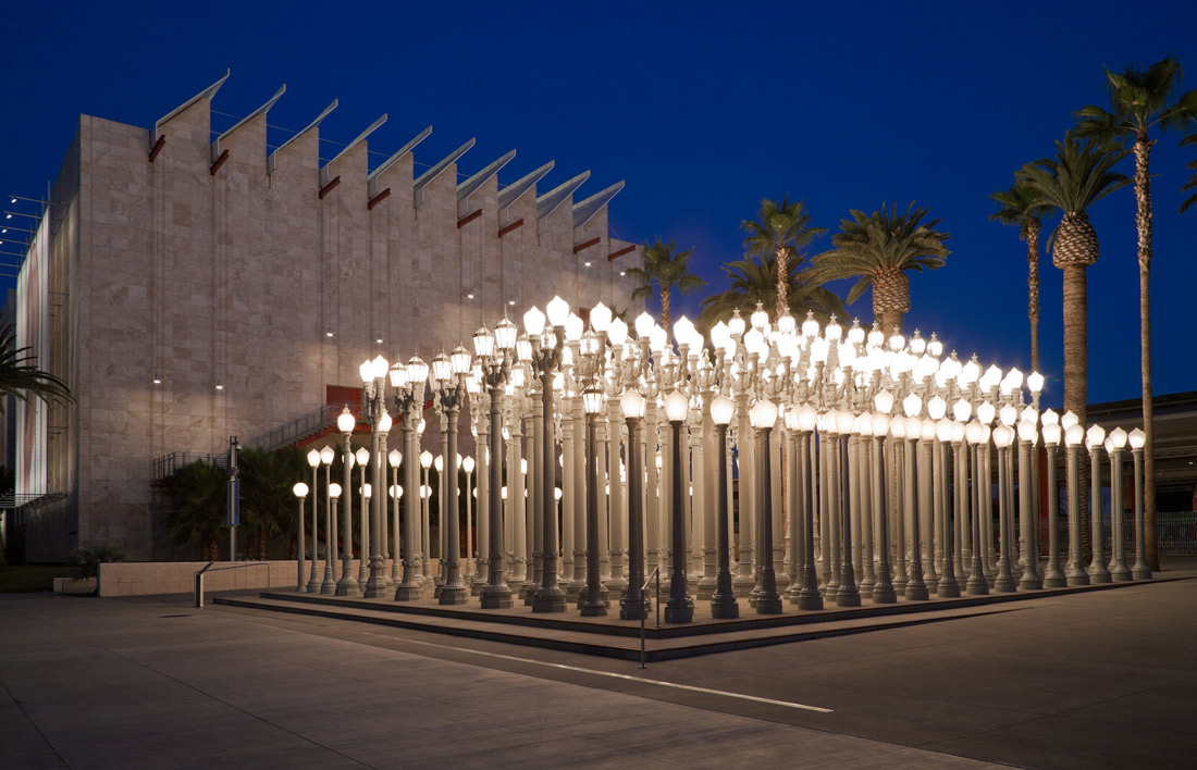 exterior image of lacma lights a night, dozens of streetlamps all together